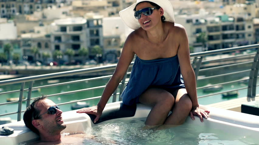 Rich people having fun in jacuzzi, slow motion shot at 120fps  - HD stock video clip