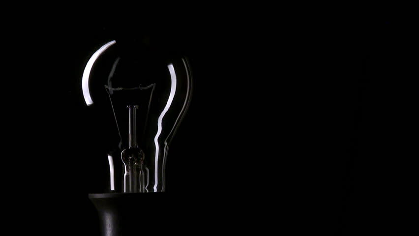 Real light bulb turning on and turning off on black background, copy-space, HD, loopable - HD stock video clip