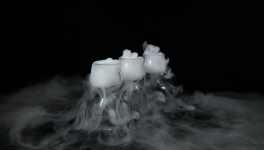 drink in glass with the effect of dry ice - HD stock footage clip