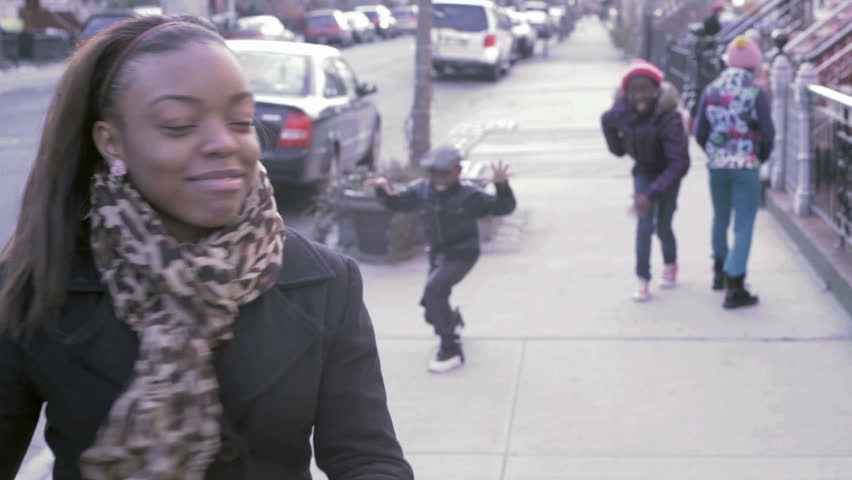 Young African American black kids running and playing in the street - HD stock video clip