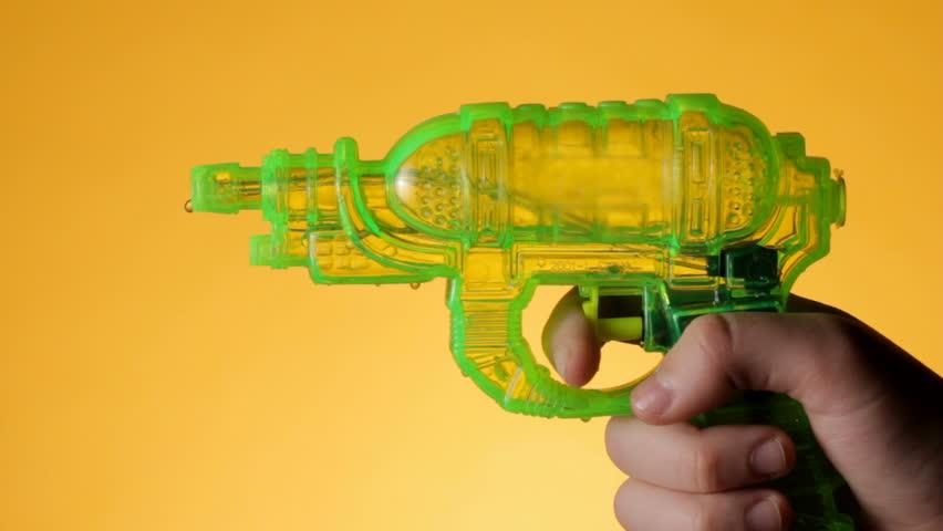 Shooting a water gun