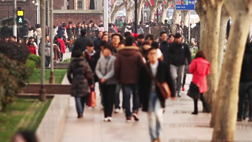 Busy Street Traffic in Shanghai, China. Anonymous Crowd.