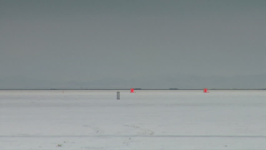 dragster passes camera at high speed on Bonneville salt Flats - HD stock video clip