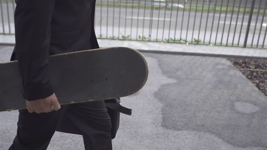 SLOW MOTION: Young businessman with skateboard - HD stock video clip