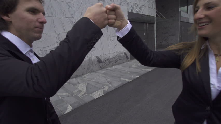 SLOW MOTION: Businessman and businesswoman fist bump - HD stock video clip