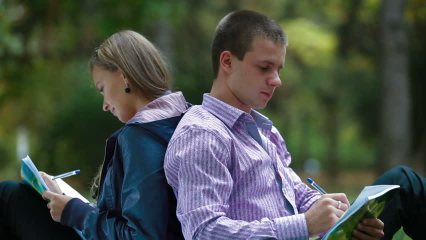 Friends studying in autumn park - HD stock footage clip