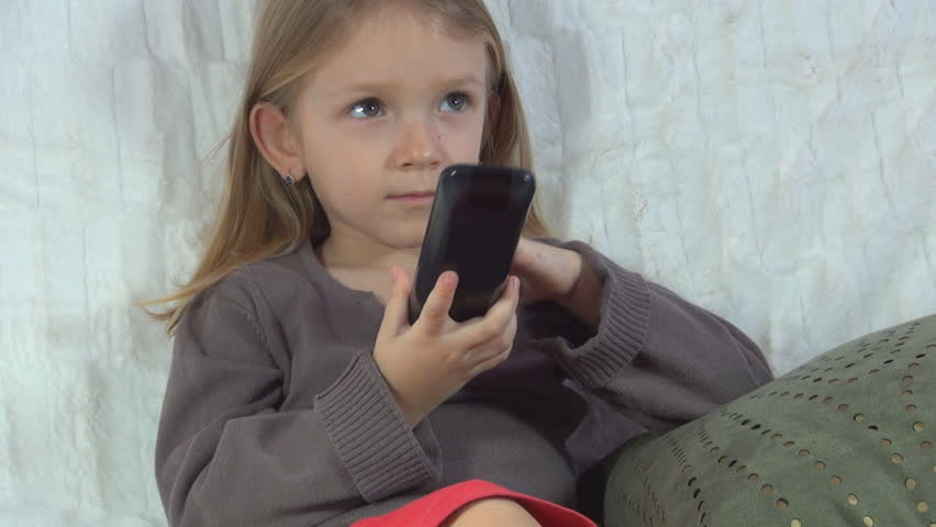 Child Watching TV, Little Girl Handling Remote Control, Children - HD stock footage clip