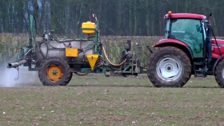Tractor Spraying Fertilizer Onto A Crop Of Winter Wheat (Staffordshire,UK - March 2013) - 02666698