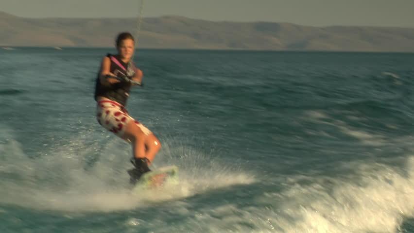 teenage girl wakeboarding - HD stock footage clip
