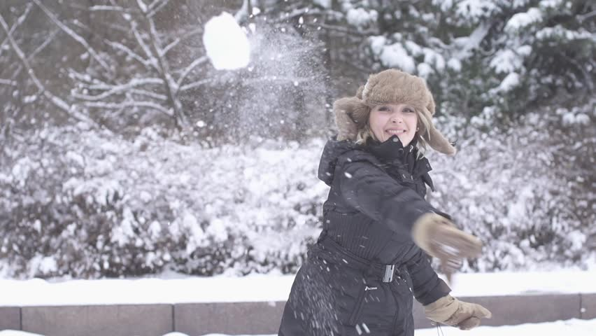 slow motion  young woman throws snowball into camera stock footage video 4318583