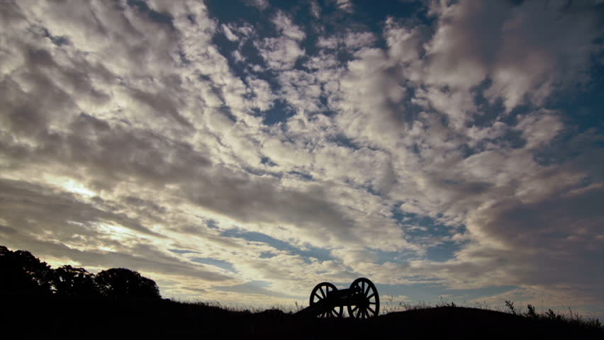 Cloud time-lapse with cannon silhouette at historic battlefield in Yorktown, Virginia, USA