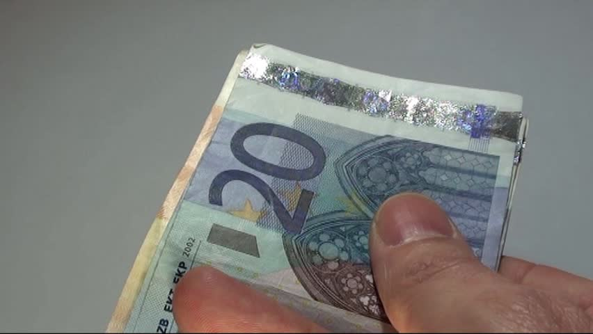 hand of a banker who has a lot of money in euro banknotes - HD stock video clip