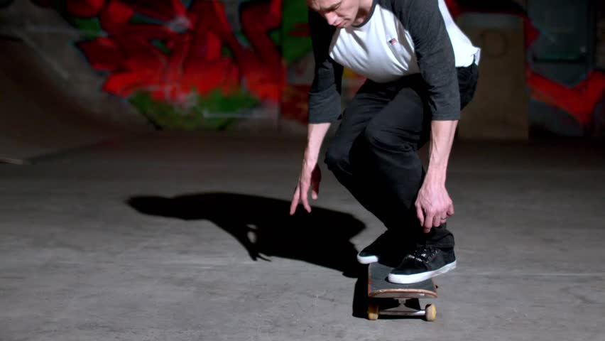 Front view of skater doing 360 flip in slow motion - HD stock video clip