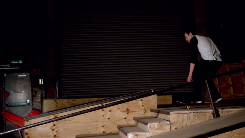 Skater doing dipped ollie down steps in slow motion - HD stock footage clip