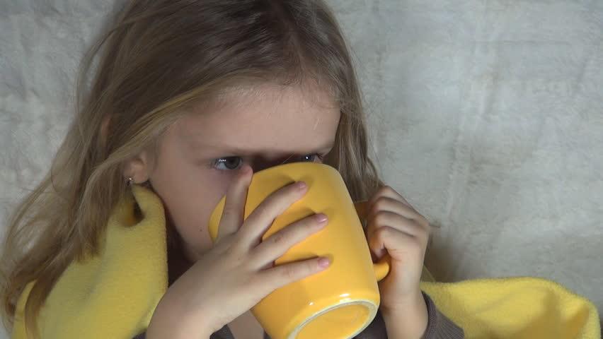 Child being Cold Drinking Tea to Warm, Sick Little Girl, ill Kid, Children - HD stock footage clip
