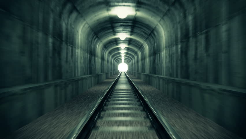 Take a ride through old-looking rail tunnel with a light at the end. Can represent achieving your goals, getting through problems and obstacles or simply represent exactly what you can see - HD stock footage clip