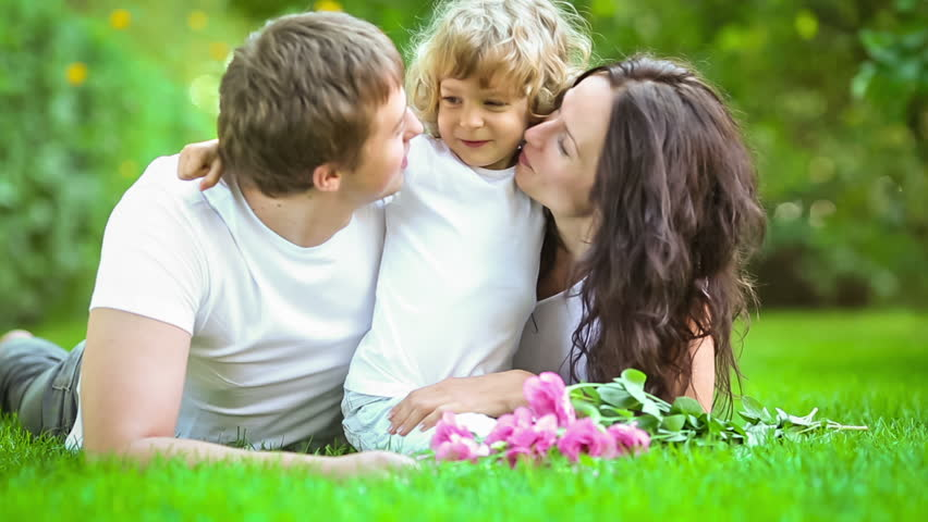 Happy family having fun outdoors in spring park. Slow motion - HD stock footage clip