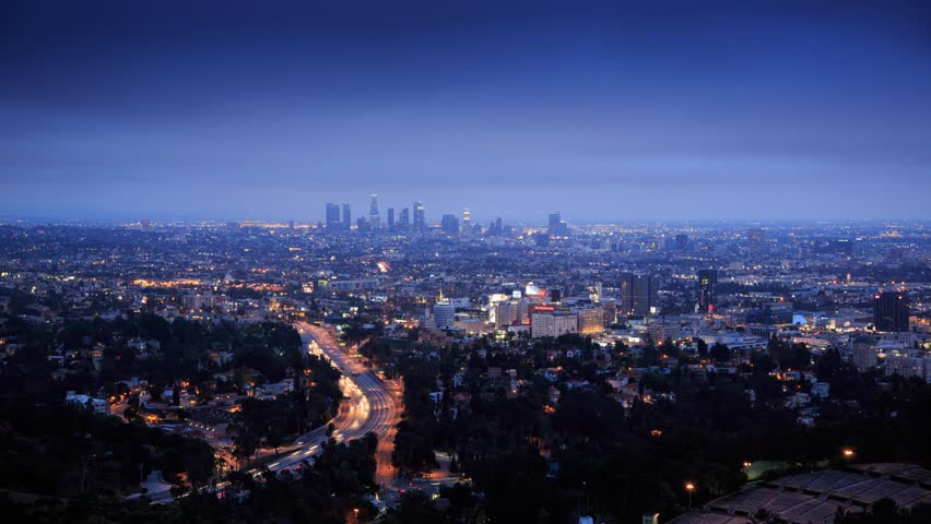Los Angeles city timelapse. Transition from dusk to night. View from Hollywood Hills on freeway 101 and downtown LA.