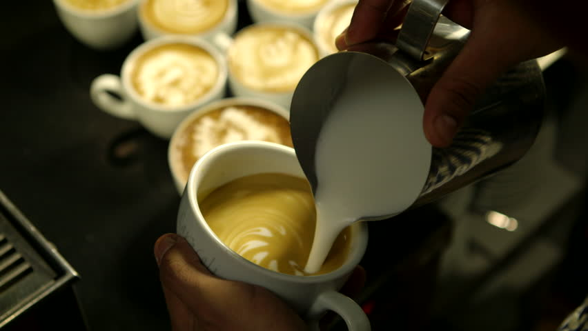 Barista makes pattern in coffee