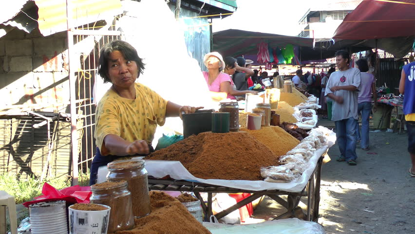 PANAY ISLAND, PHILIPPINES - CIRCA MARCH 2013: People buying sugar on a market in Sibalom