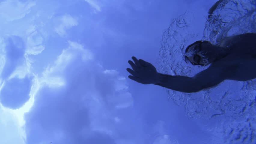 scene of a swimmer training taken from below . silhouetted.  - HD stock video clip