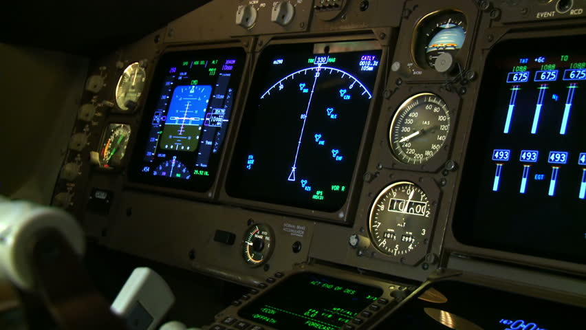 Detail of instruments being adjusted in a Boeing 747 cockpit. Shot with a