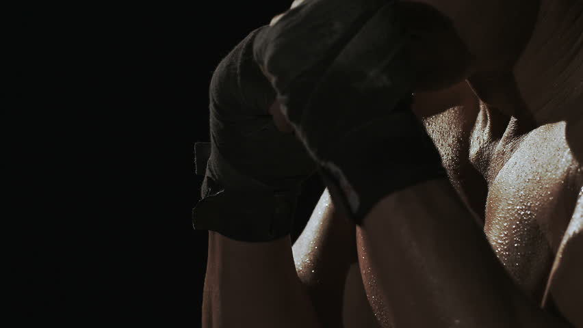 Kickboxer shadow boxing as exercise for the big fight, shot on Red Epic - HD stock video clip