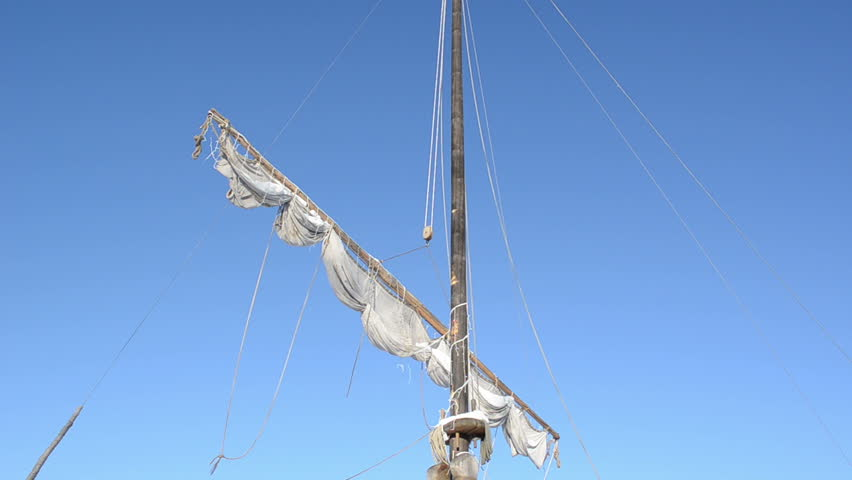 retro wooden ship sail move in wind on background of blue sky. - HD stock footage clip