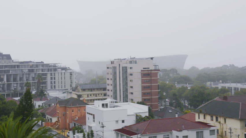 Rain dropping from the sky in the Cape town city - HD stock footage clip