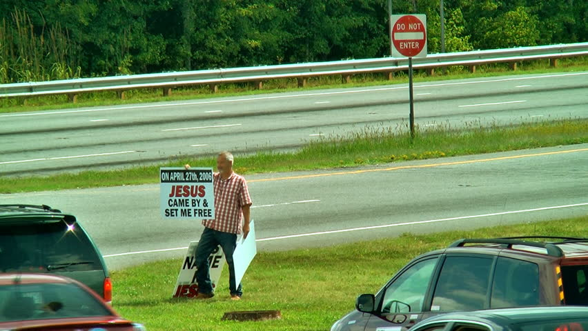 FOREST CITY, NC - CIRCA AUGUST 2010:  Christian witnesses share their testimony on the street corner, Forest City, North Carolina circa August 2010.