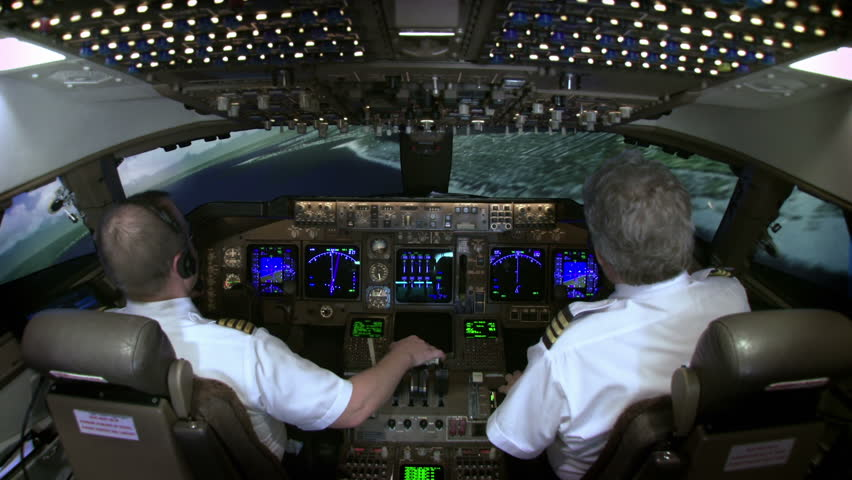 High view of 747 cockpit as pilot brings plane in to land at John F Kennedy Airport in New York, USA.