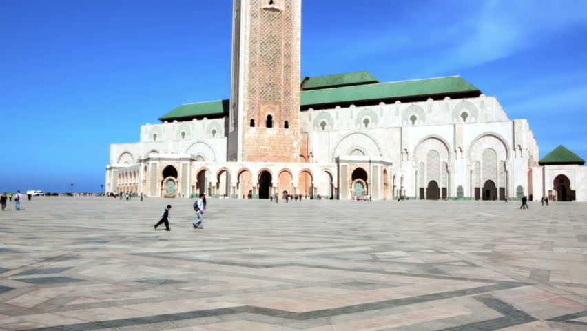 CASABLANCA, MOROCCO - OCT 16: Prayers and tourists sightseeing the exterior of the Mosque Hassan II on October 16, 2010 in Casablanca, Morocco.