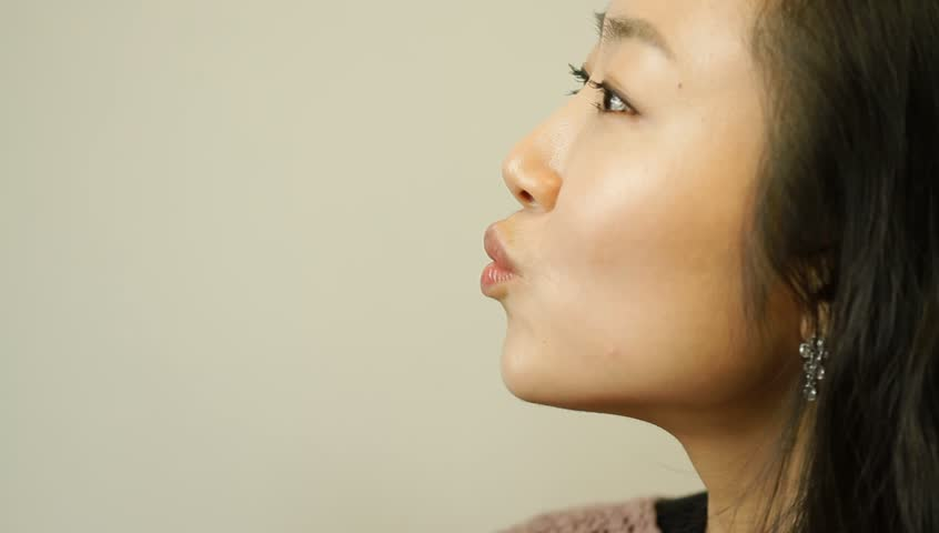Young asian woman making mouth kissing gesture - HD stock footage clip
