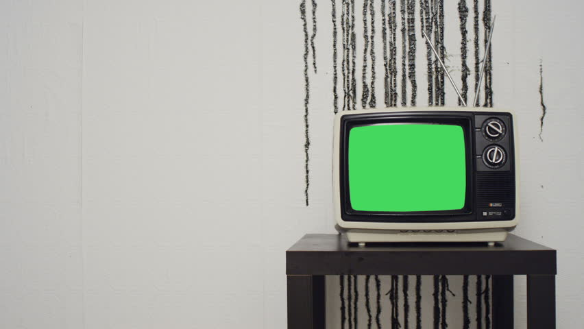 Retro TV in front of grungy wall (wide version) | Shutterstock HD Video #3748919
