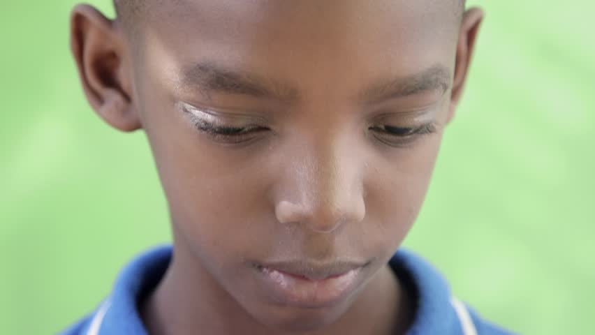 Child portrait, serious african american boy looking at camera. Sequence - HD stock footage clip