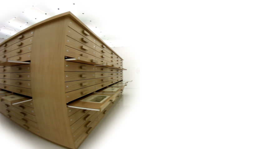 Close up shot of several narrow drawers, some are opened and some are closed