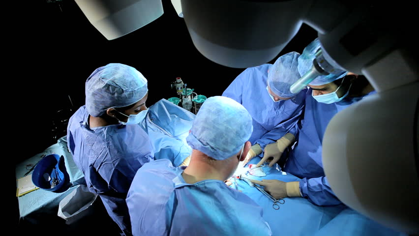 Medical students in training assisting surgeon in hospital operating room overhead | Shutterstock HD Video #3782039