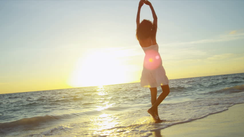 Happy Latin American girl having fun beach on luxury island at sunrise shot on RED EPIC | Shutterstock HD Video #3789815
