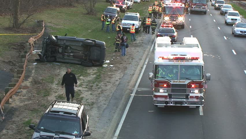 April 5, 2009 - Long Island, NY - Overturned Car Accident Scene on Highway with Fire Trucks - HD stock footage clip