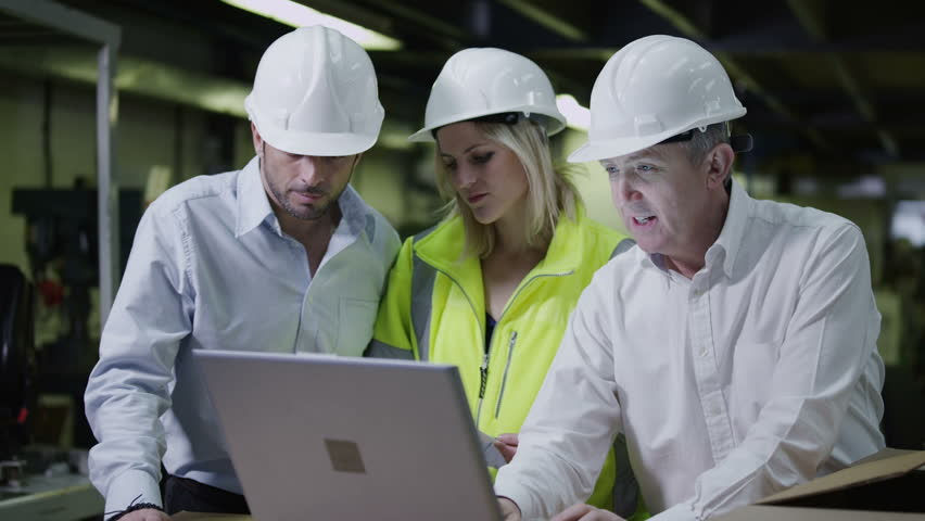 Male and female warehouse workers are looking at a laptop computer and discussing the logistics of their business. In slow motion. #3808076