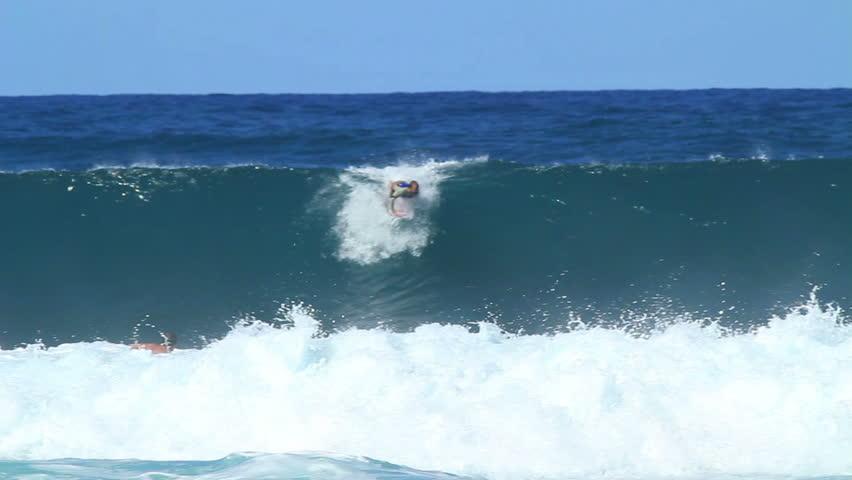 Surfer Gets Barreled Then Does Air