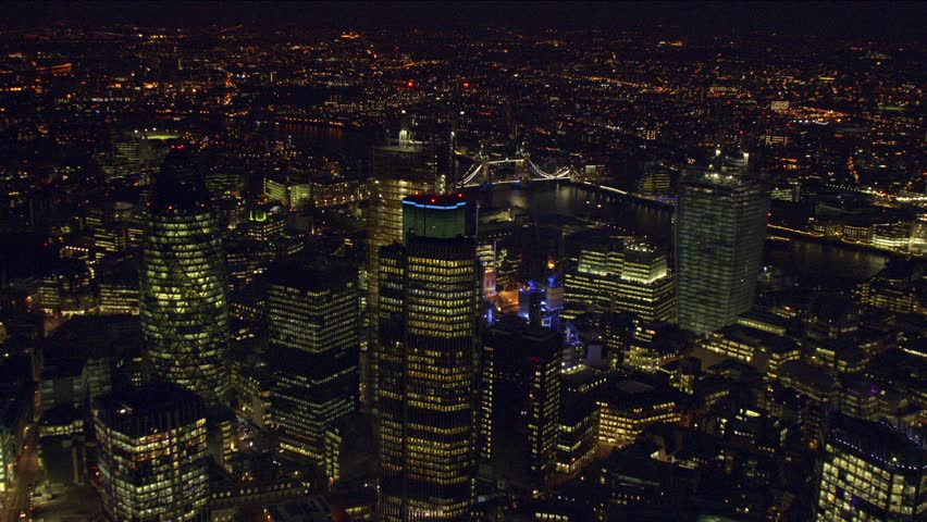 Panoramic aerial shot of The City of London at night