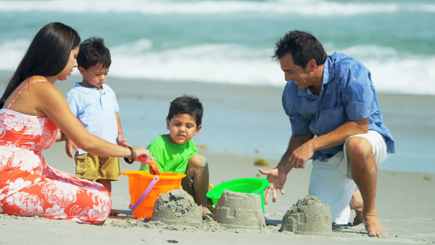 Loving Hispanic family spending summer vacation playing on sandy beach shot on RED EPIC - HD stock video clip