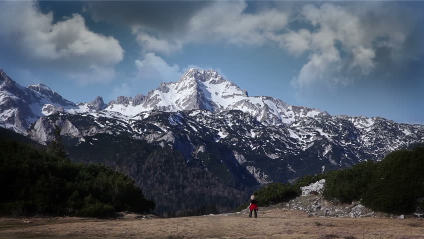 Shot of snowy mountain peak on the cloudy day - HD stock footage clip