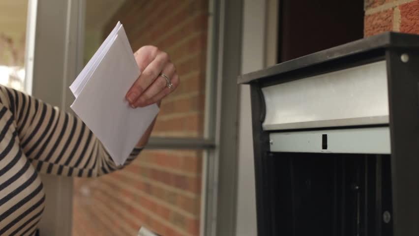 Woman getting mail smiles jib shot - HD stock video clip