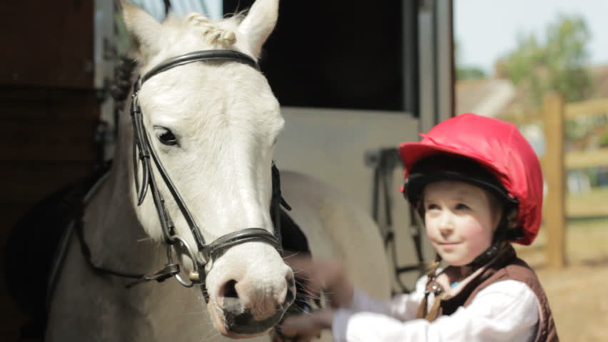 PORTRAIT: Little girl and horse - two shots of a little girl and a white pony - HD stock footage clip