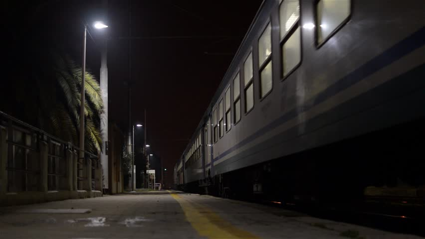 PORTO SAN GIORGIO, ITALY - SEPT 29, 2012 - Passenger train leaving the station at night.