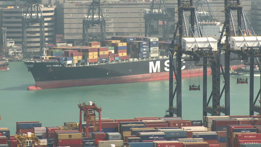 HONG KONG, CHINA - AUGUST 2012: Container Ship Arrives At Port. Shot overlooking