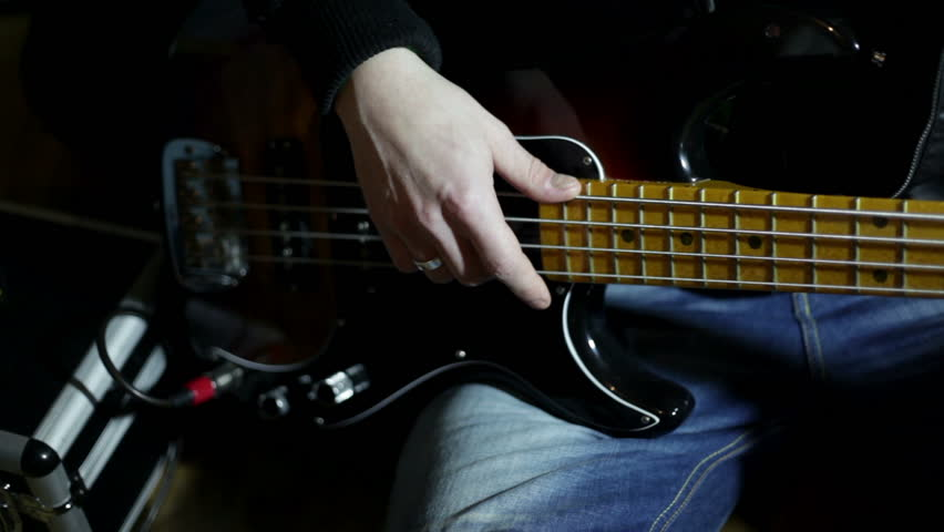 close up shot of musician playing guitar - HD stock footage clip