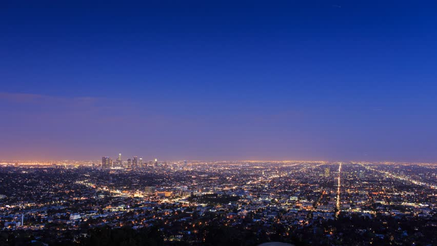 Los Angeles skyline cityscape changing from dusk to night. Timelapse.